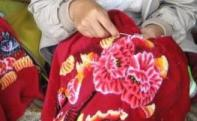 Lady stitching embroidery